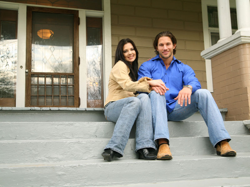 Couple Sitting on Home Steps